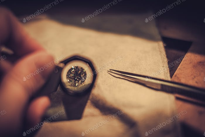 Jeweler during the evaluation of jewels