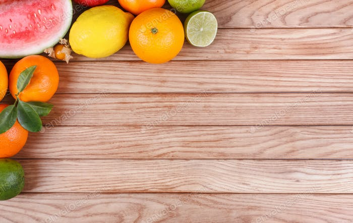Fruits on wood texture background with space for text.