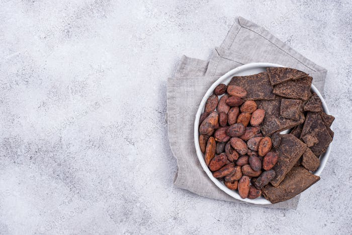 Cocoa beans and pieces of chocolate