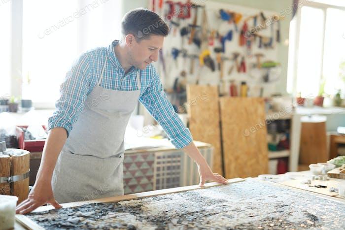 Artist Creating Mosaic