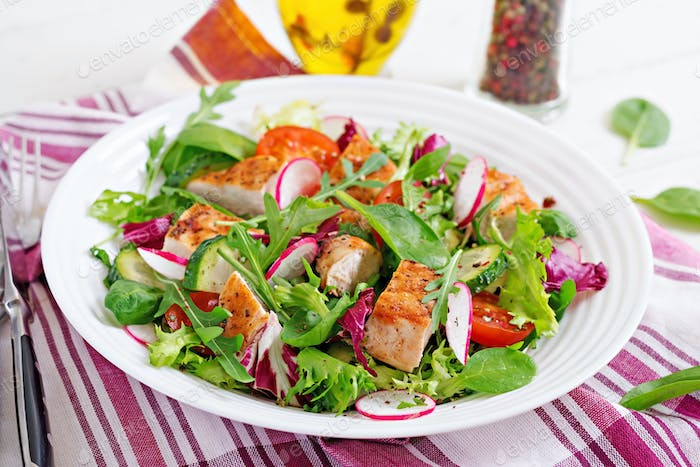 Fresh vegetable salad with grilled chicken breast   - tomatoes,