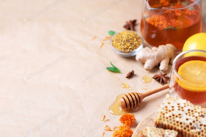 Autumn harvest concept. Set of honey and bee products, apple, lemon, spices on craft paper