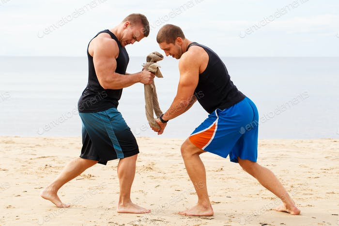 Bodybuilders on the beach