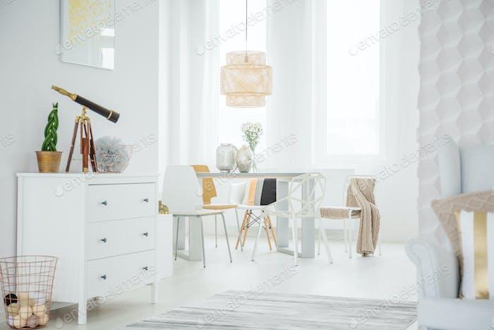 White loft interior with dresser