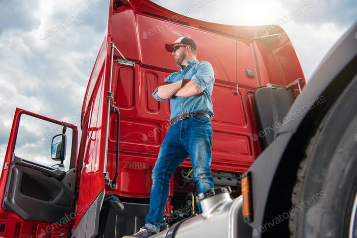 Proud Trucker and His Brand New Semi Truck Tractor