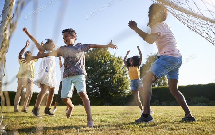 Celebrating goal at a multi generation family football game