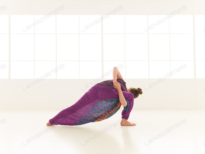 young woman in yoga pose indor