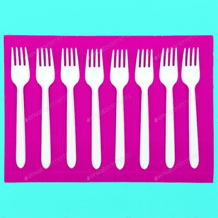 Set  plastic forks. Plastic life. Minimal art