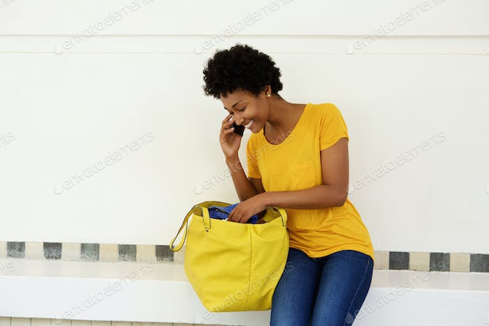 Young african woman making a phone call