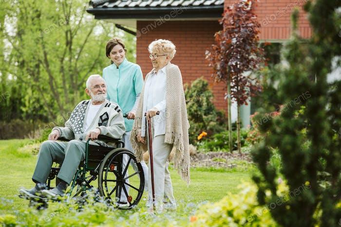 Senior man on the wheelchair in the garden of professional nursing home