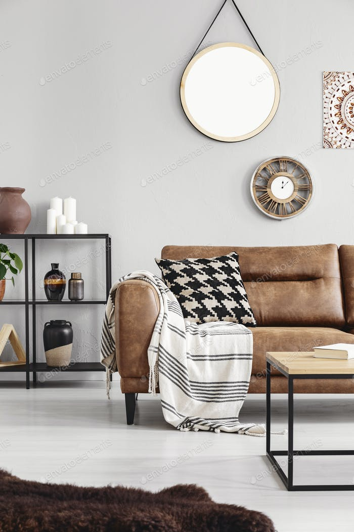 Vertical view of warm ethno living room with leather couch with