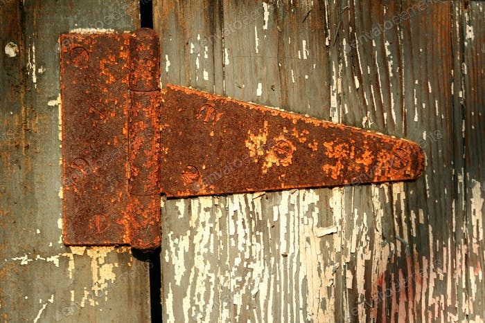 Old rusty door hinge