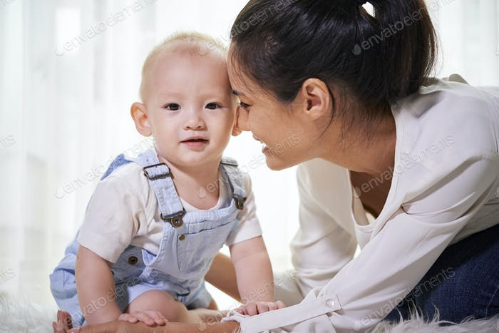 Mother looking at child with love