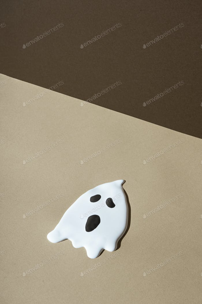 Halloween minimal concept. autumn or fall colors with ghost. Creative holiday background.