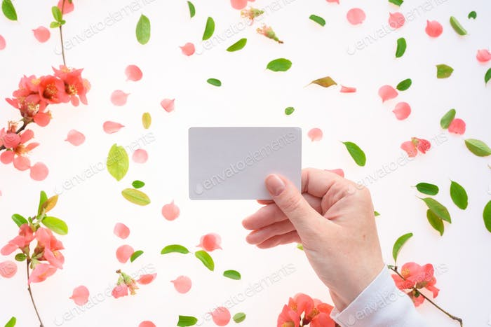 Woman holding blank white business card mock up