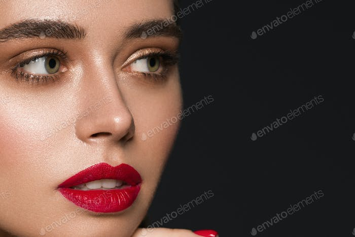 Fashion model woman make up red lips beauty female black background