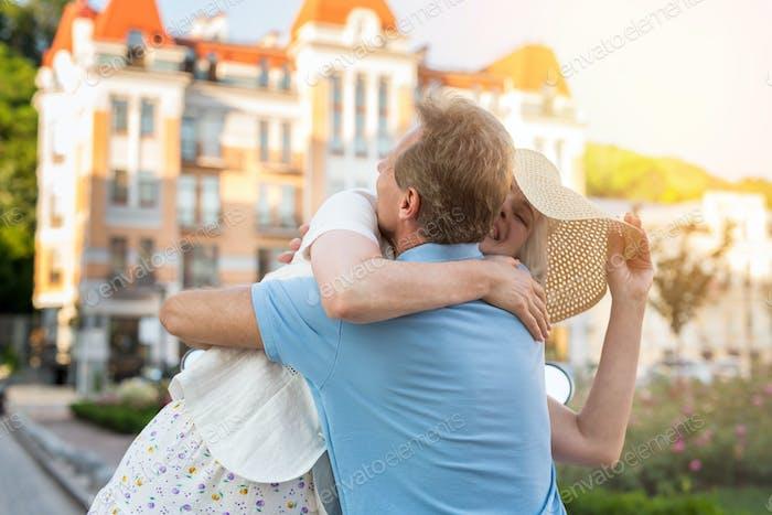Adult woman hugs man