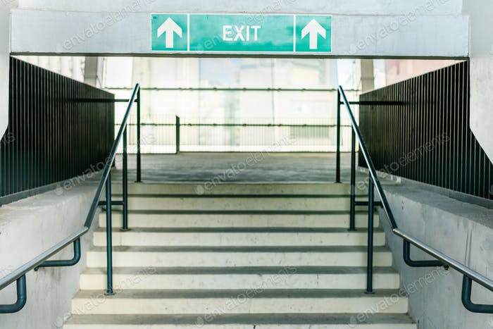 stadium stairs and green exit symbol, black and white