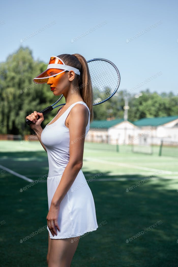 Attractive girl on the tennis court