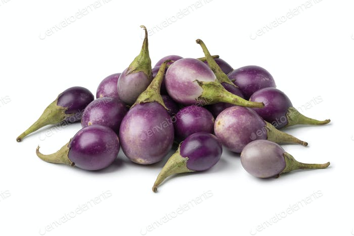 Heap of fresh raw purple mini eggplants