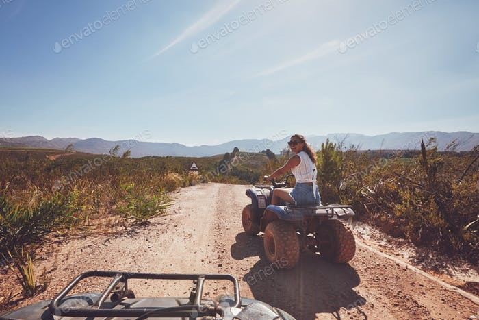 Young woman on an all terrain vehicle in nature