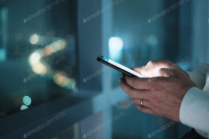 Hands Of Business Man Typing Text Message On Phone