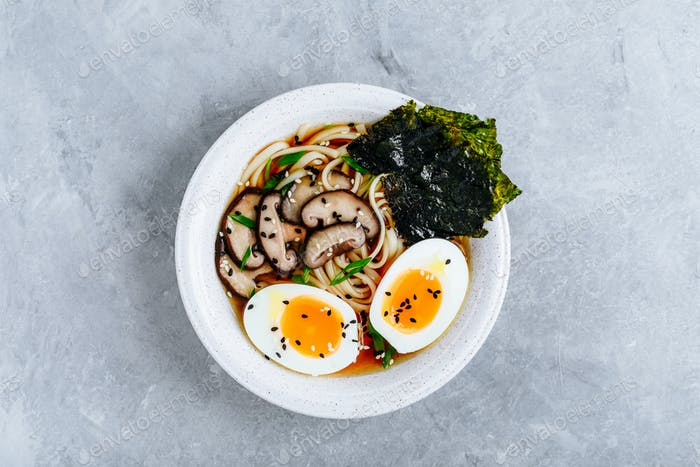 Asian Vegetarian Udon or Ramen noodles soup in bowl with Shiitake