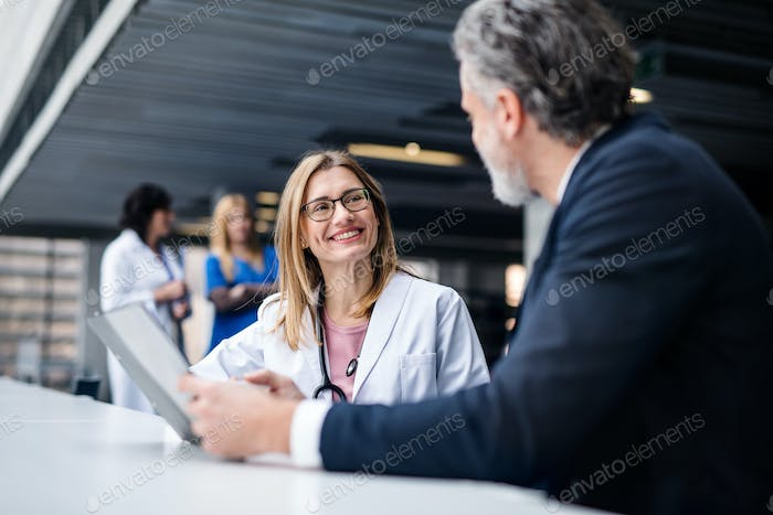Doctor talking to a pharmaceutical sales representative
