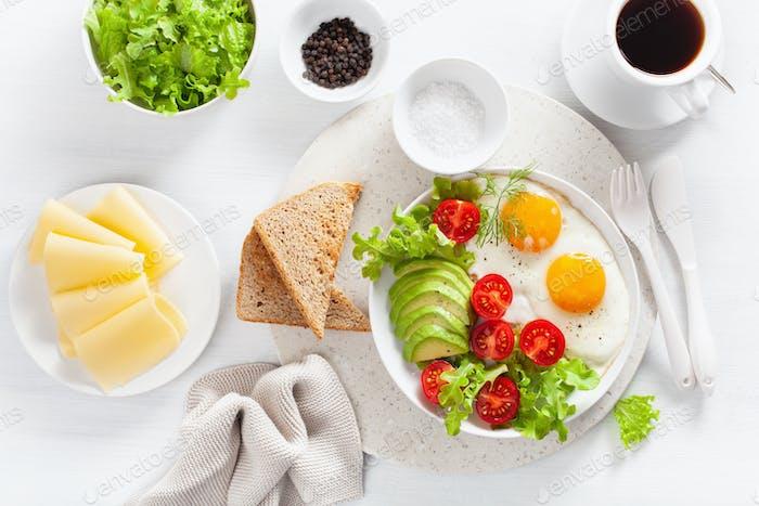 healthy breakfast flat lay. fried eggs, avocado, tomato, toasts