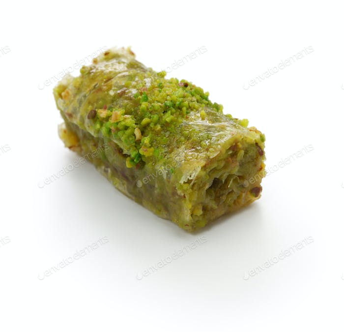 pistachio rolls baklava, fistikli sarma, turkish traditional dessert isolated on white background