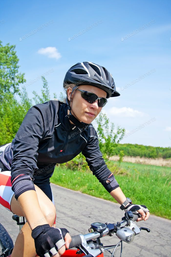 Woman riding on bicycle on summer day