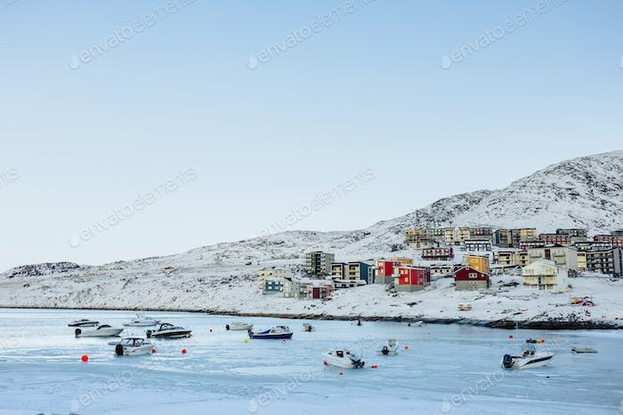 Frozen sea with residential buildings