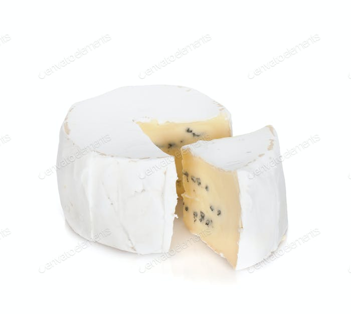 A piece of soft brie cheese