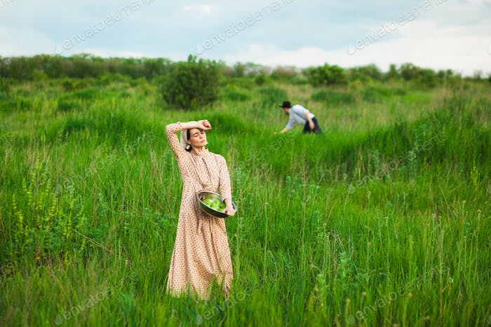 The healthy rural life. The woman in the green field