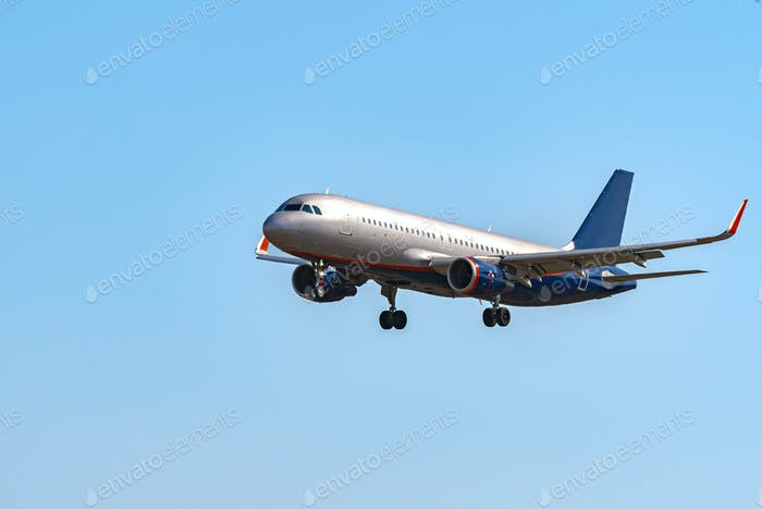 Passenger airplane flying against clear blue sky