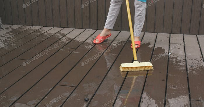 Cleaning the floor with yellow brush
