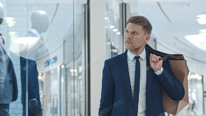 Young businessman with shopping bag