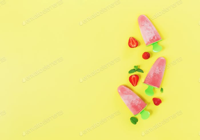 Fruity frozen sorbet ice-cream with strawberry, mint on yellow background
