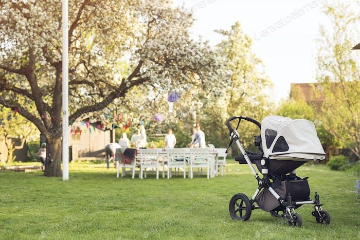 Baby carriage in garden