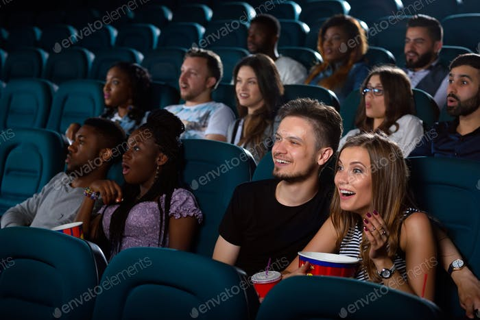 Lovely young couple on a date at the cinema