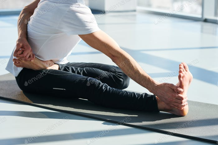 Stretching exercise on mat