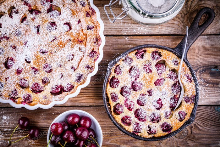 Clafoutis cherry pie on  wooden background