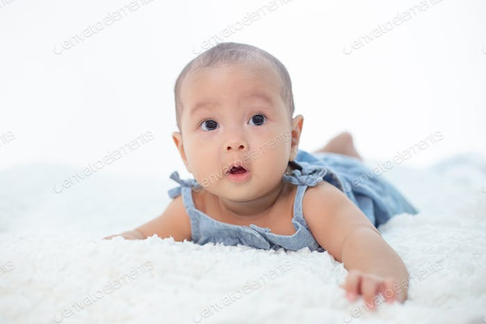 A little boy lying in the bed