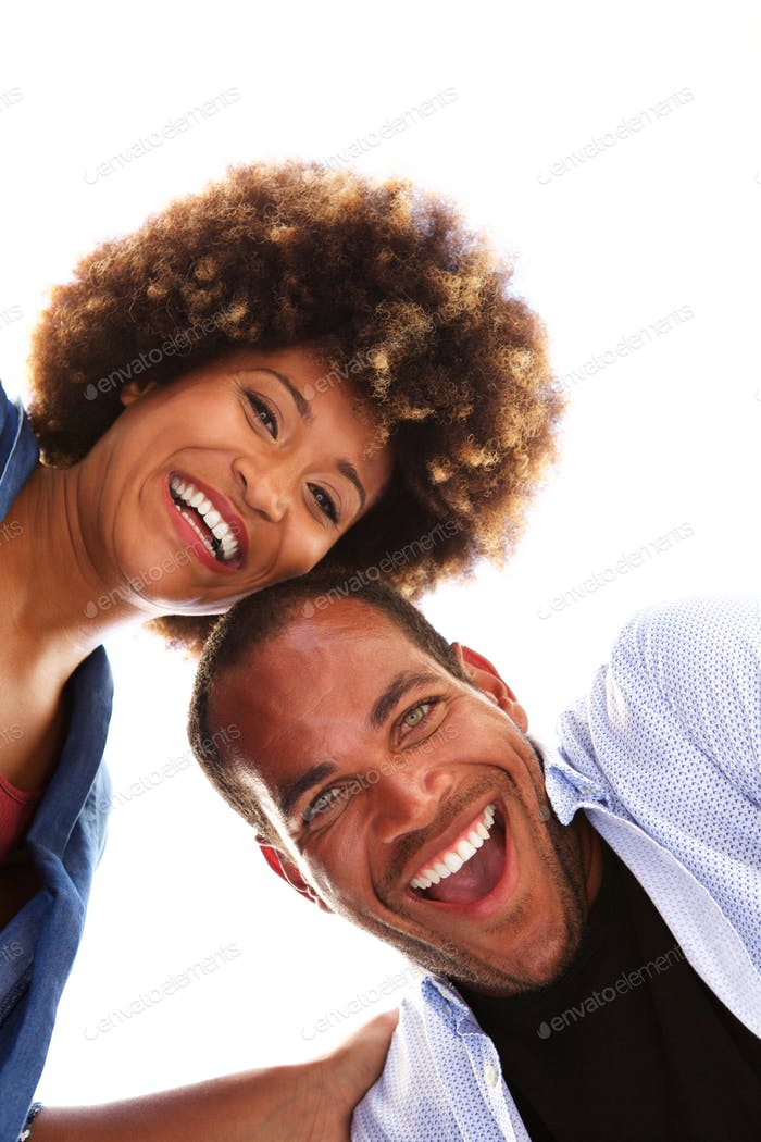 Close up happy fun couple laughing together on white background