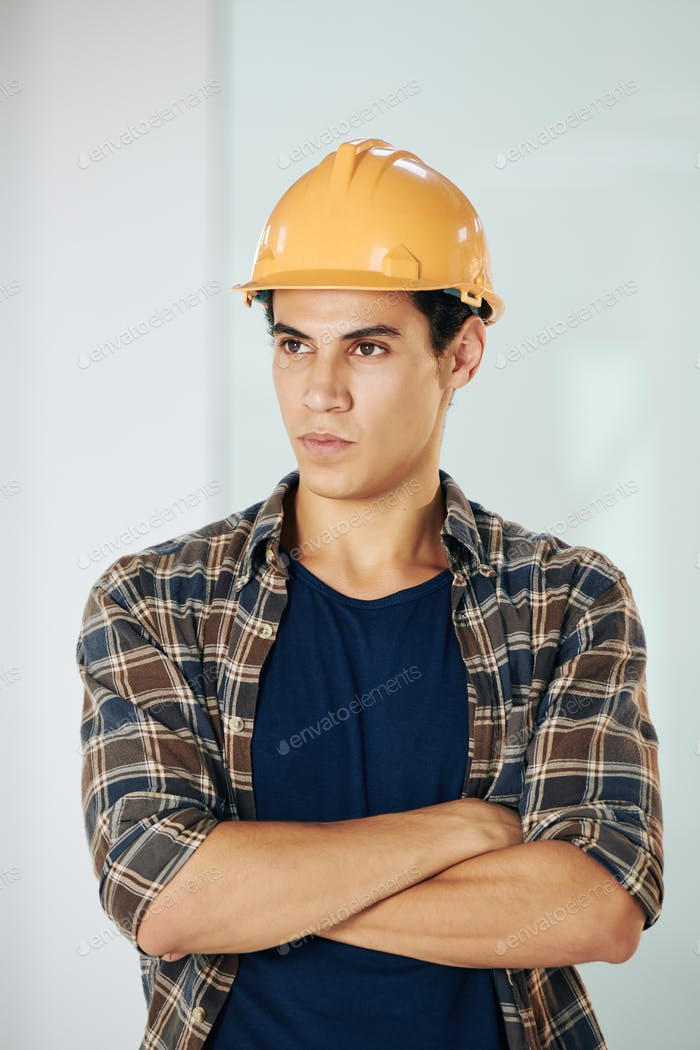 Serious young builder
