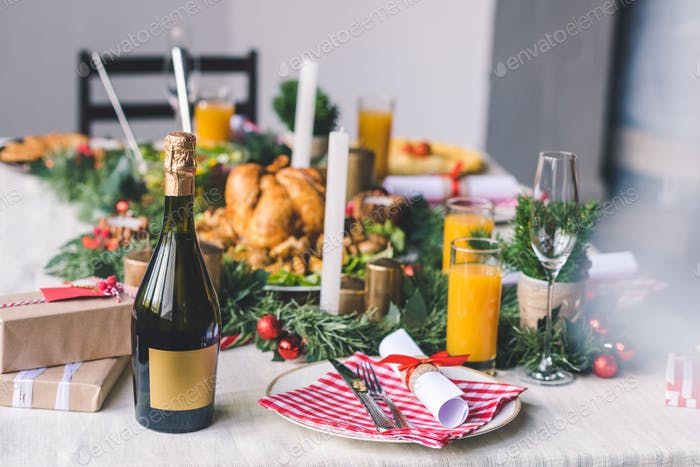 christmas decorated table with delicious dishes