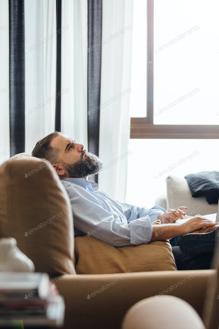 Side view of businessman with laptop
