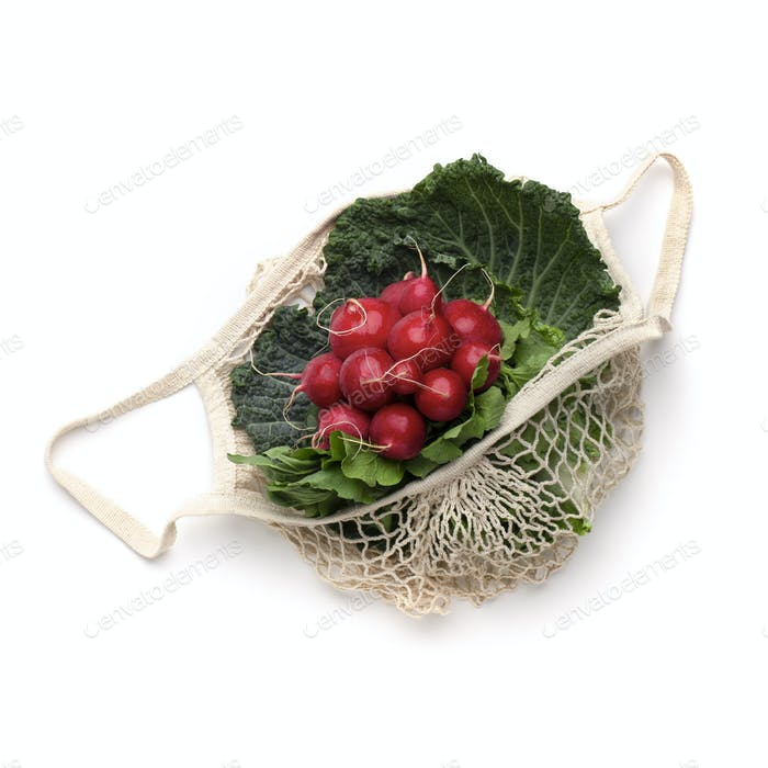 Reddish and green leaves for salad inside eco string bag