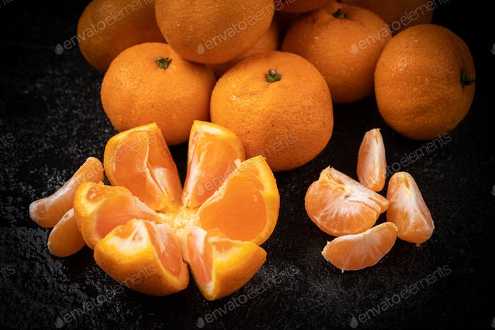 Juicy mandarin on  black background. Mandarin Fruit