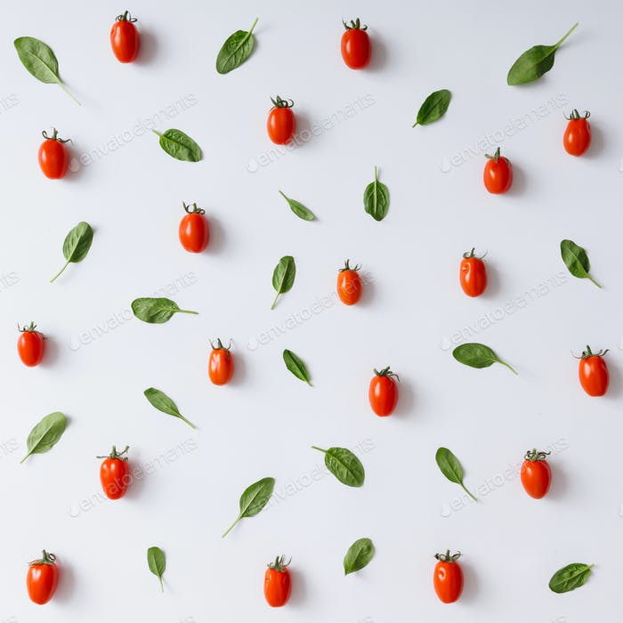 Cherry tomatoes and basil leaves pattern.